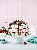 Meringue tart with cherries and cream
