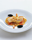 Turbot cooked in Anapurna curry oil with trumpet mushroom confit, root vegetables and pine nuts