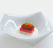 Cream of stockfish soup with grilled watermelon
