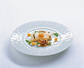 White halibut with lemon confit, seafood, muscovado vinegar and onion gnocchi