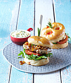 Chicken burger with caramelized onion and potato bun