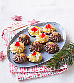 Black and white Christmas cookies with candied fruits