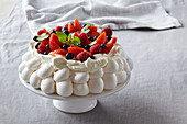 Baiser cake with whipped cream and fresh berries