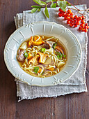 Wild boar consomme with chantarelles