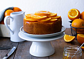 Orange cake served with candied oranges