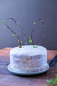 Easter cake with bunny ears made from willow branches
