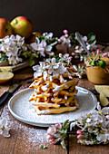 Vanilla waffles with icing sugar and apple sauce