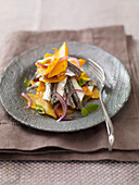 Mille-feuille of anchovies and red onions