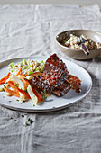 Beef ribs with vegetable sauce and barley groaths
