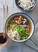 Beef soup with udon noodles