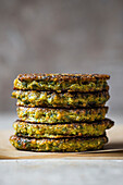 Lentil and Greens Patties stacked with copy space