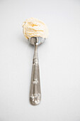 Single scoop of vanilla ice cream