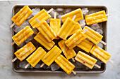 Mango Lassi Popsciles on marble surface