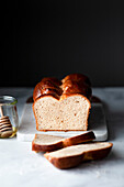 A loaf of sliced brioche bread