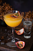 A passionfruit martini (Maverick) topped with a quarter of passion fruit and served with sparkling wine