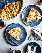An Egyptian Phyllo Milk Pie (Um Ali) plated on blue dishes