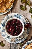 Cherry sauce (cherries jubilee) in a tea cup