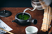 Japanese green tea made with loose leaves being poured