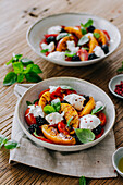 Tomato and peach salad with burrata and blackberries