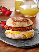 Mexican Chorizo sausage patty with fried egg and cheese on an english muffin breakfast sandwich