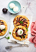 Mini galettes with plums and lemon ice cream