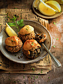 Black rice arancini au gratin