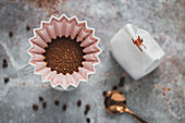 Origami coffee filter with coffee powder