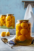 Apricots preserved in syrup jars