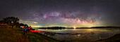 Milky Way rising above a lake