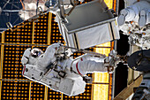 NASA astronauts carrying out ISS repair work