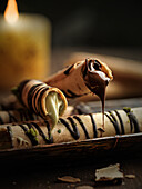 Filled wafer rolls with chocolate and pistachio cream