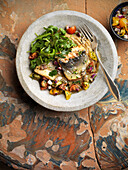 Roasted gilthead with vegetables and rocket salad