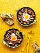 Oven baked eggs with mushrooms and bacon