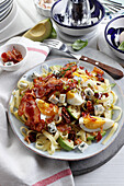 Protein salad with egg, bacon and avocado on pasta