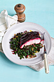 Fish fillet with beetroot and chard vegetables