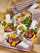 Roast beef rolls with a tuna-and-cream cheese filling