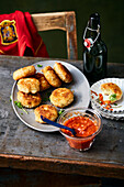 Bacalhau fritters with tomato dip
