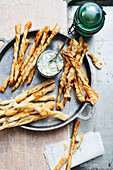 Three types of cheese sticks with a chive dip