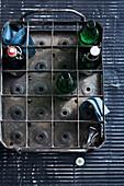 Beer bottles in metal drink stand