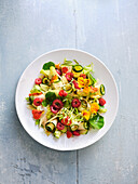Leaf salads with raw courgette and raspberry vinaigrette