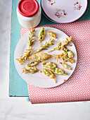 Fried herb leaves with icing sugar