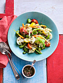 Mixed summer vegetable salad with lovage