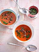 Soup of baked tomatoes with parsley oil and crackers