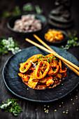 Ojinger Dobbab with squid, kimchi and gochujang sauce (Korea)
