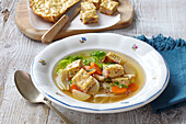 Vegetable broth with ham scroll (omelet)