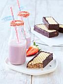 Homemade chocolate and hazelnut wafers with strawberry milk