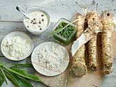 Horseradish still life with pesto, horseradish mayo, horseradish cream