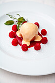 Poached peach with zabaglione and raspberries