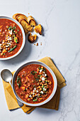 Smoky lentil and barley soup with crispy chickpeas and feta