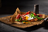 Three-grain bread with bacon, poached egg and rocket salad